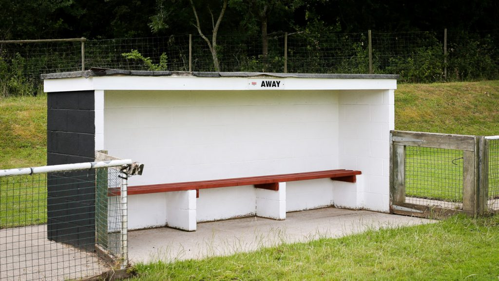 The away dugout at Binfield FC. Photo: Neil Graham / ngsportsphotography.com